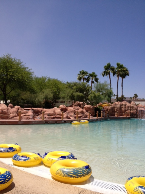 Pretty view of the Oasis Water Park pool area with a healthy amount of tubes for all.