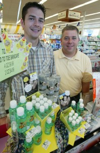 Toe Juice Sales Manager Jared Hawkes & CEO Rhett Garner show their Toe Juice display at Walgreens. (photo courtesy of  Tim Hacker/EastValleyTribune.com)