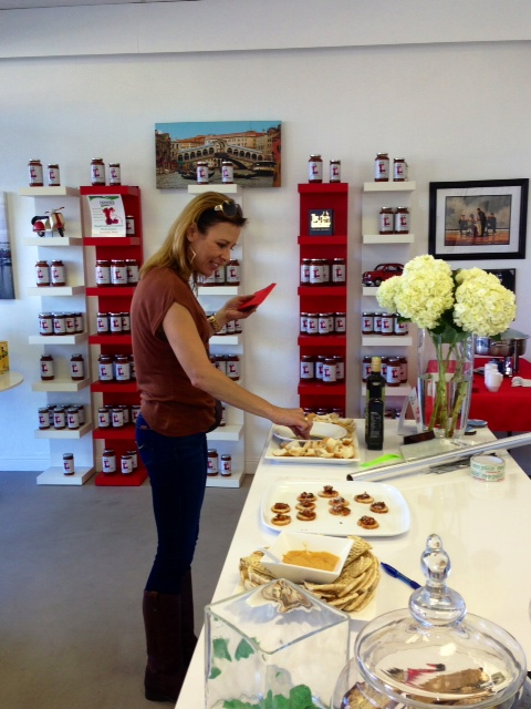 My friend, Julie tasting the grand opening samples.  All yummy!
