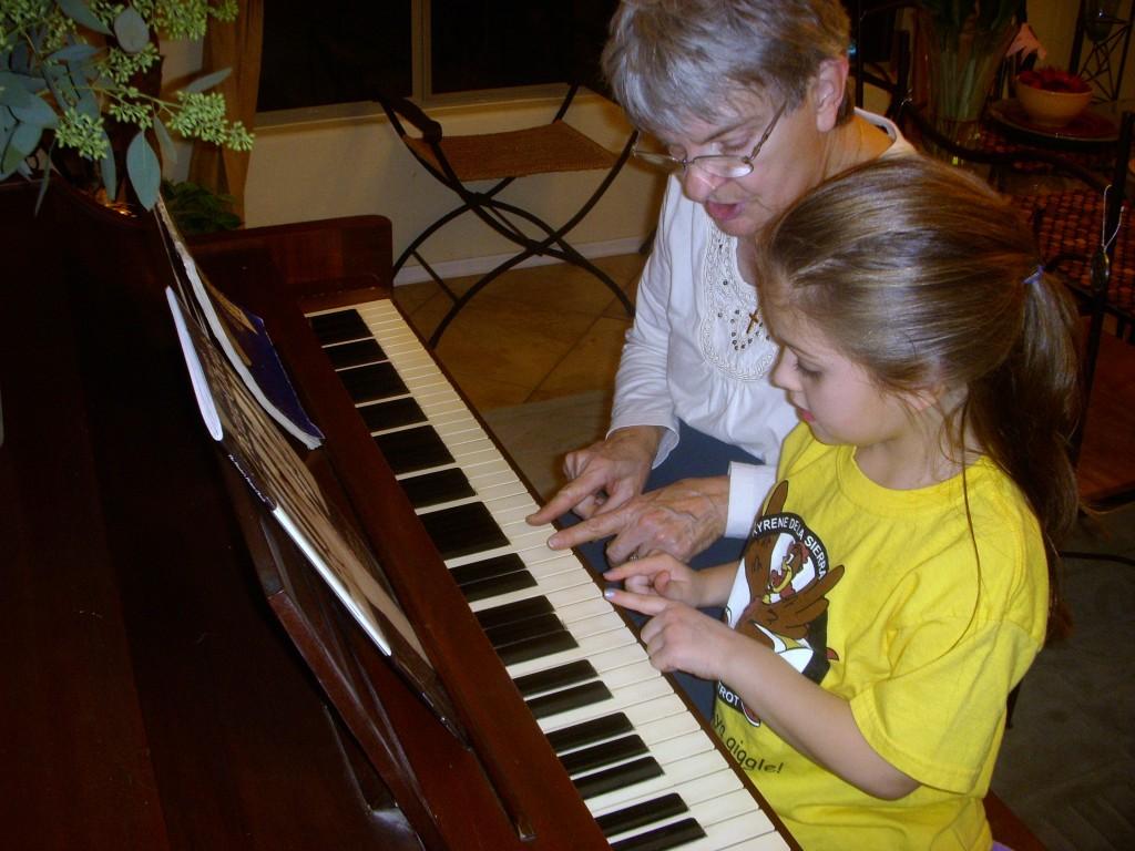 Betty teaches Alexis piano