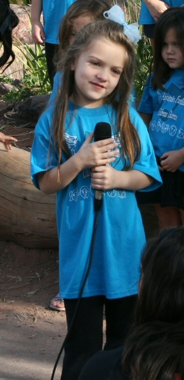 At only 6 years old, she was proudly singing a sweet little solo with the Ahwatukee Children's Theatre All Keyed Up Show Choir at a Phoenix Zoo performance.