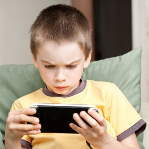 bigstock-Boy-Playing-Game-Console-8012650 (1)