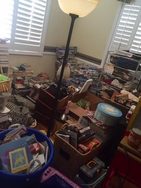 Yep! Call us hoarders! That WAS one of our rooms! Granted, we were having hard wood floors installed so we had to move a bunch of stuff from room to room, but then is when I knew that we needed a declutter buster plan!