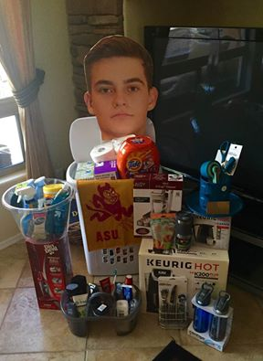 My son's surprise dorm room essentials kit put together by his sweet girlfriend and by me. Guilty of placing his face sign there! That was me and he loved the surprise...except for the face poster. LOL!